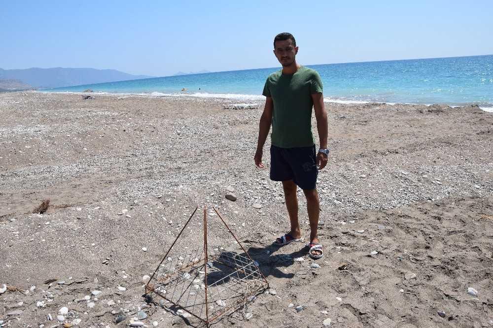 Antalya'da kepçenin caretta caretta yuvalarına verdiği zarara ilk tepki, aynı suçtan 60 bin lira ceza yiyen gençten geldi