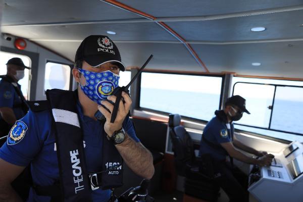 Kısıtlamadan muaf turistlere, denizden 2 dilde koronavirüs uyarısı