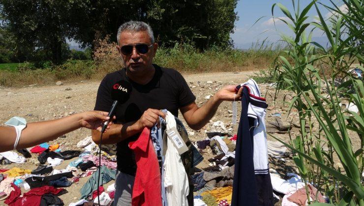 Manavgat'ta yardım için toplanan kıyafetleri dere kenarına attılar